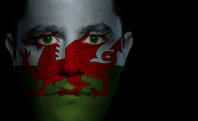 Welsh Flag Projected over Mans Face