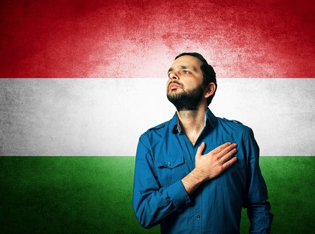 Hungarian man in front of country flag