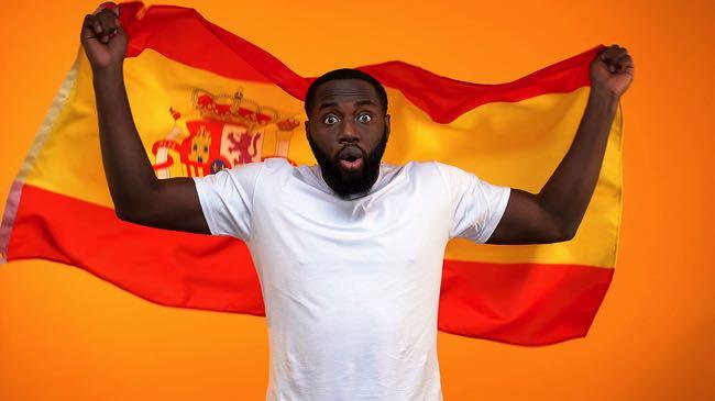 Spanish football fan looking worried